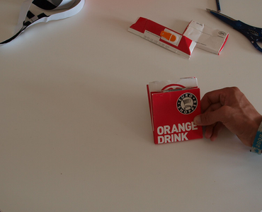 Make the First Fold, Making Sure the Part With the Lid Is Bigger!