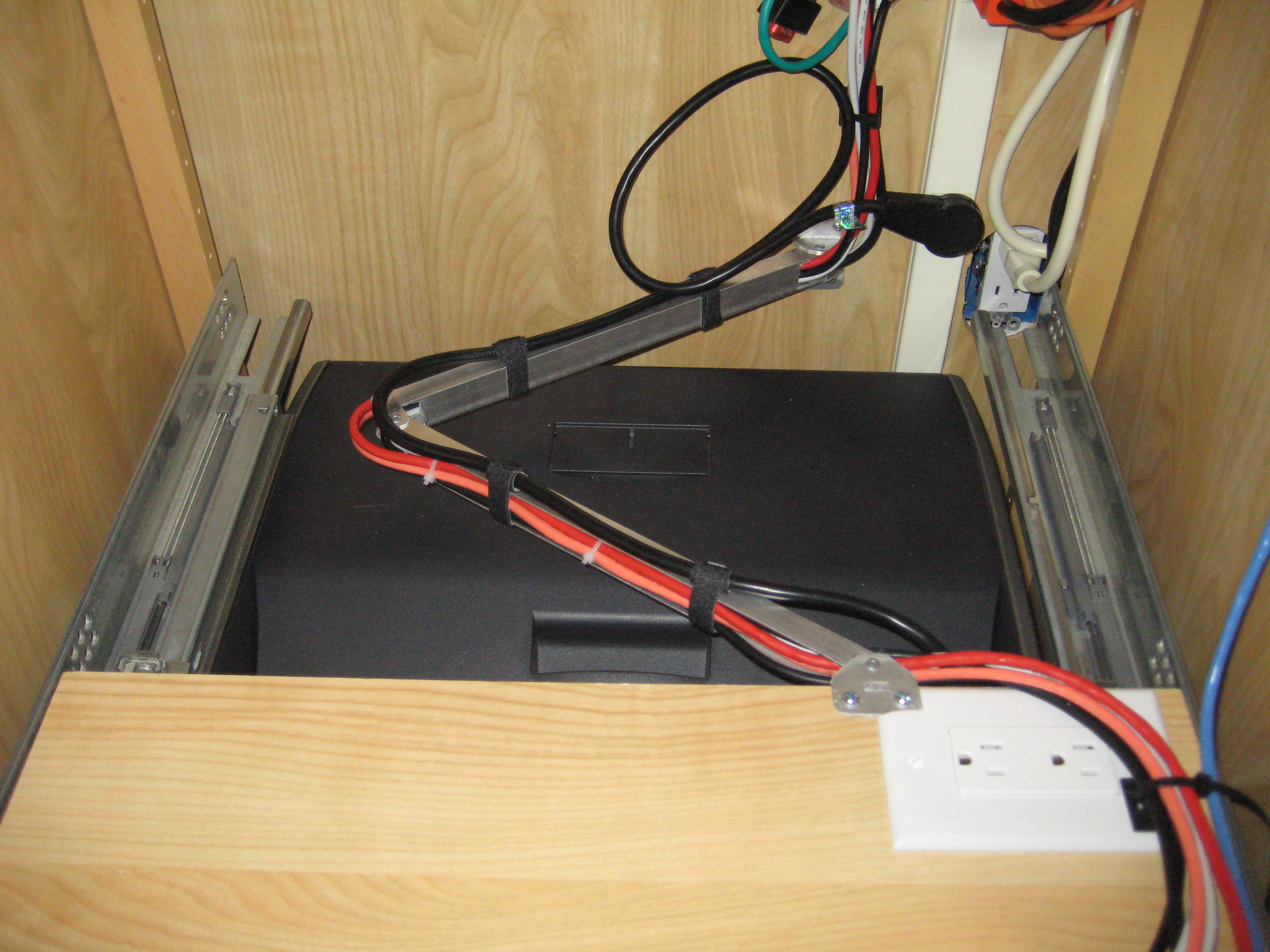 Cable control for a pull-out shelf