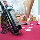 Flatpack red wine bottle holder