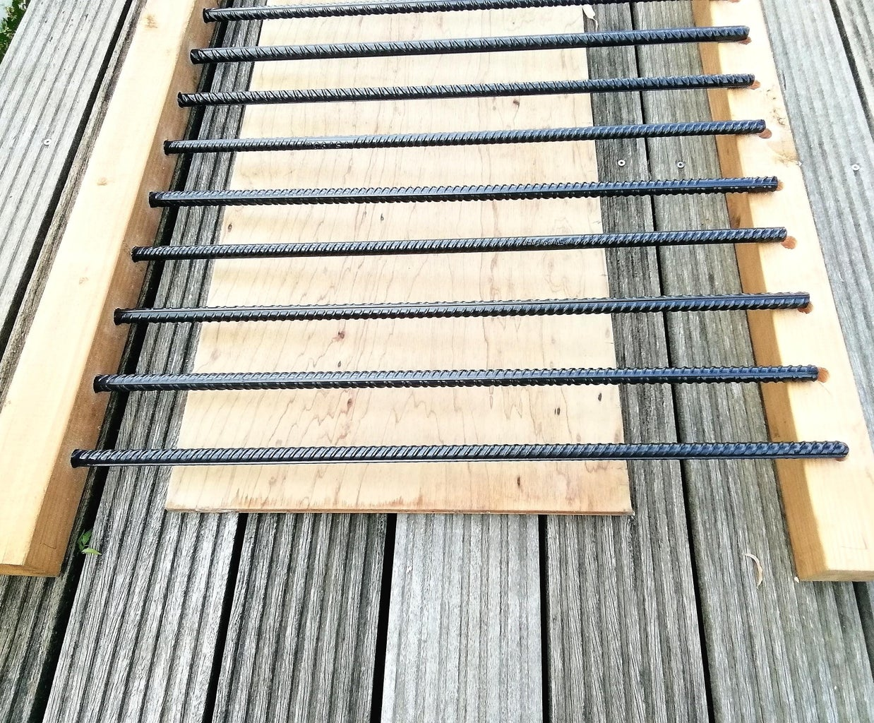 Place the Pickets in the Holes of the Rails