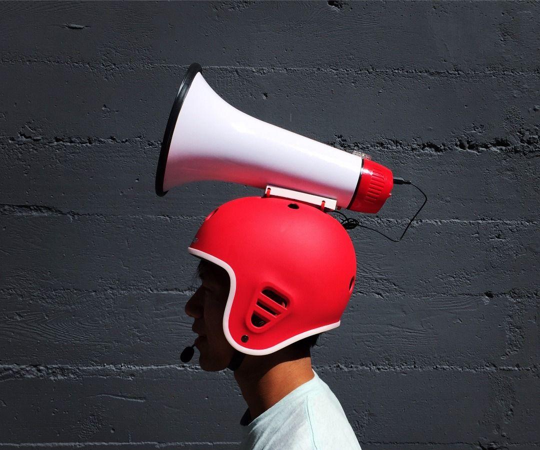 Make a Megahelmet (a helmet with a megaphone)