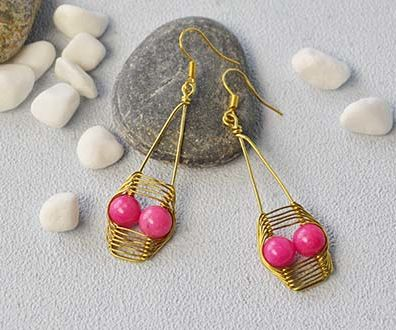 Halloween DIY Project - How to Make a Pair of Golden Wire Wrapped Skull Earrings With Pink Jade Bead