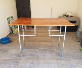 Standing Desk With Wood and Pipes