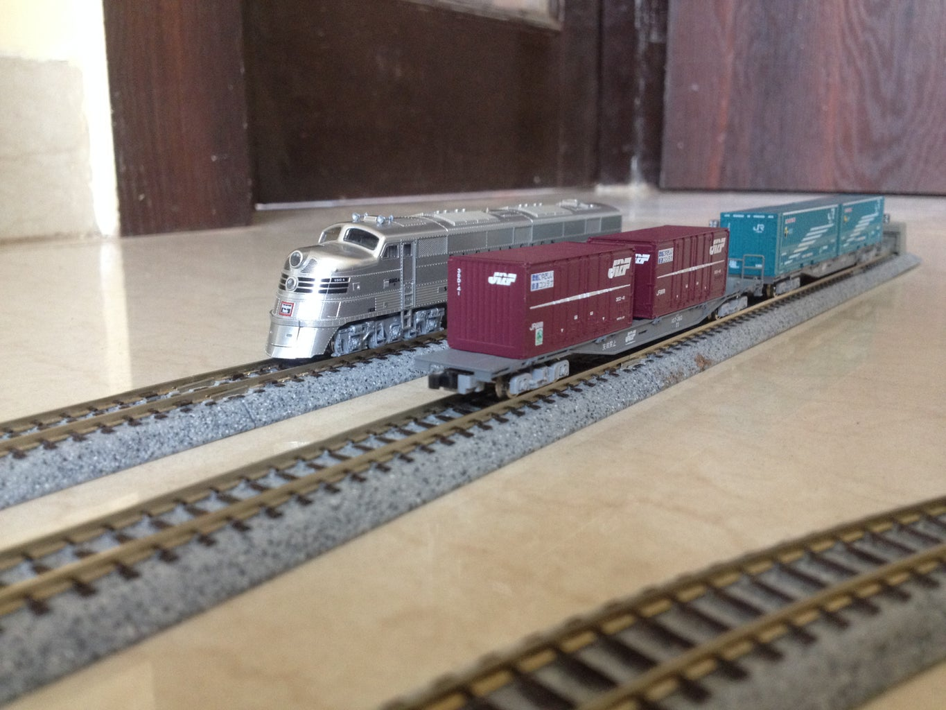 Place the Locomotive and Some Rolling Stock on the Tracks
