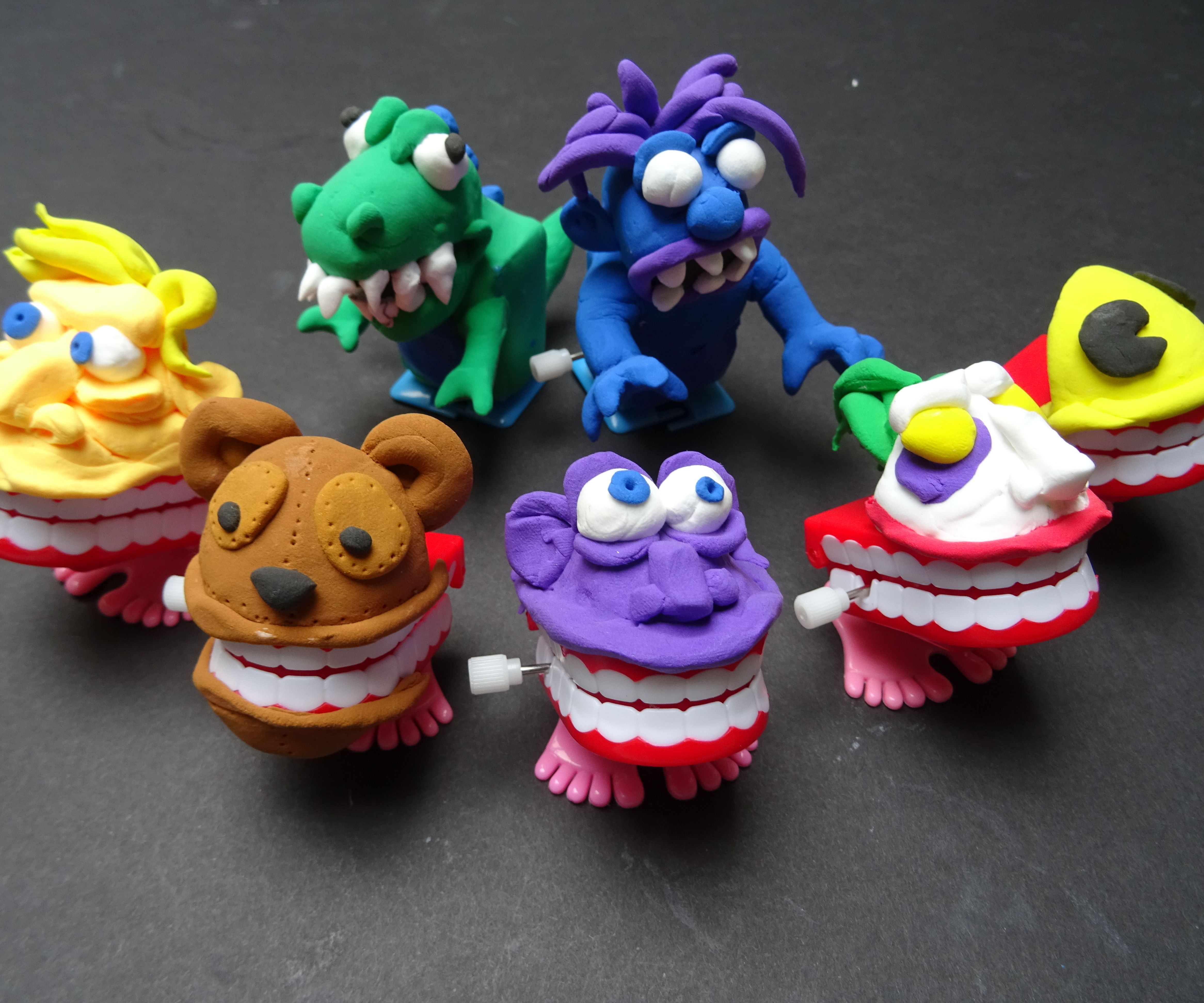 Soft clay wind up toys. Walkers and Chompers
