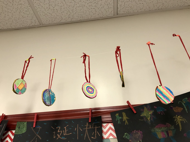 Step 7: Hang Up the Painted Cardboard Circles.