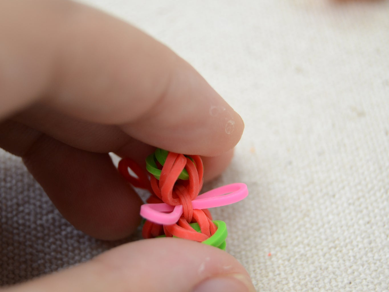 Thread a Rubber Band to  the Center Band of the Flower;