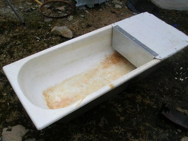 Convert a Bathtub Into a Water Trough.