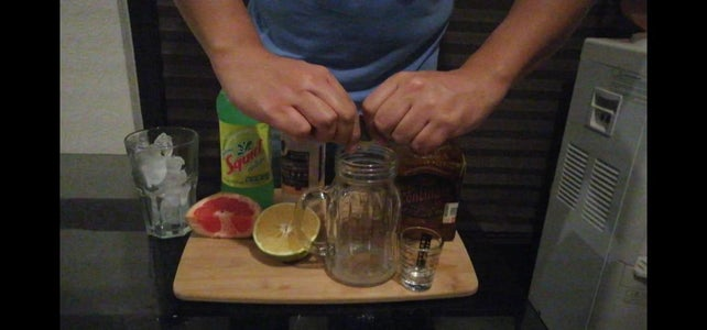Extract Juice From Fruits Over the Mason Jar.