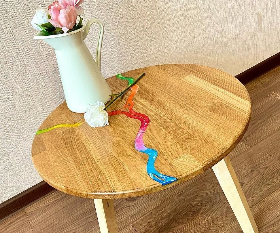 Rainbow River of Melted Crayons on Coffee Wooden Table