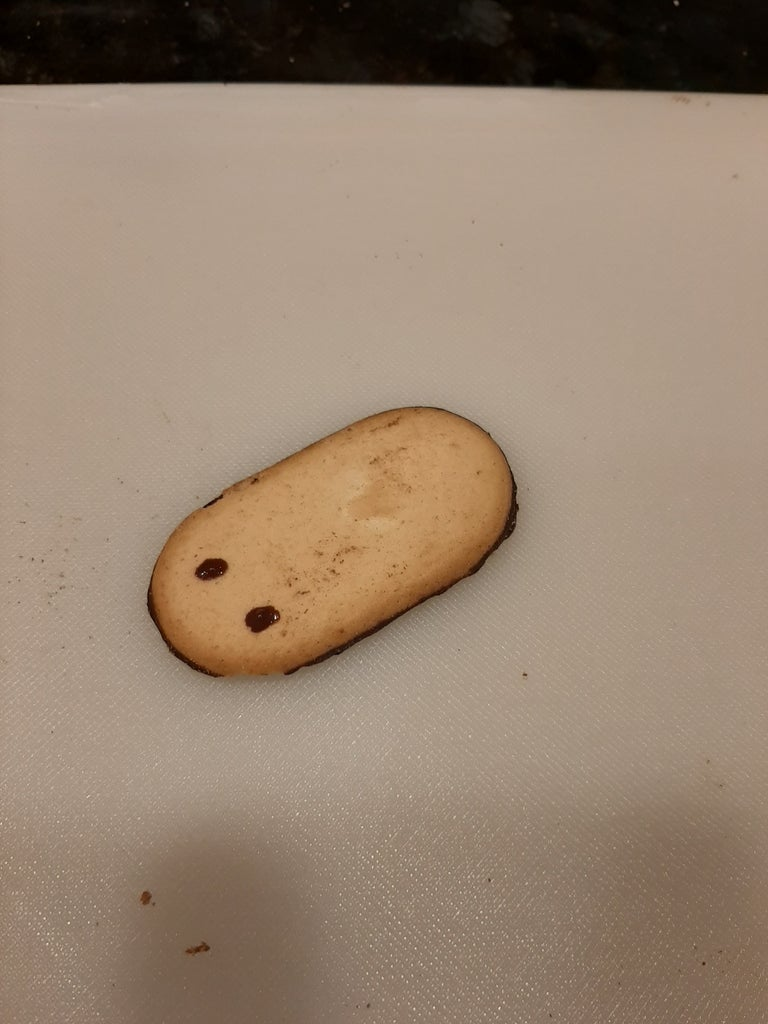 Using the Melted Chocolate Put to Dots on the Milano Cookie.