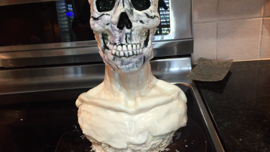 Carefully Place the Skull Onto the Bust