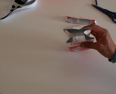 Flatten Carton by Folding in Sides