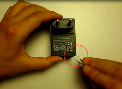 Take a Power Adaptor and Used Plugboard Apart
