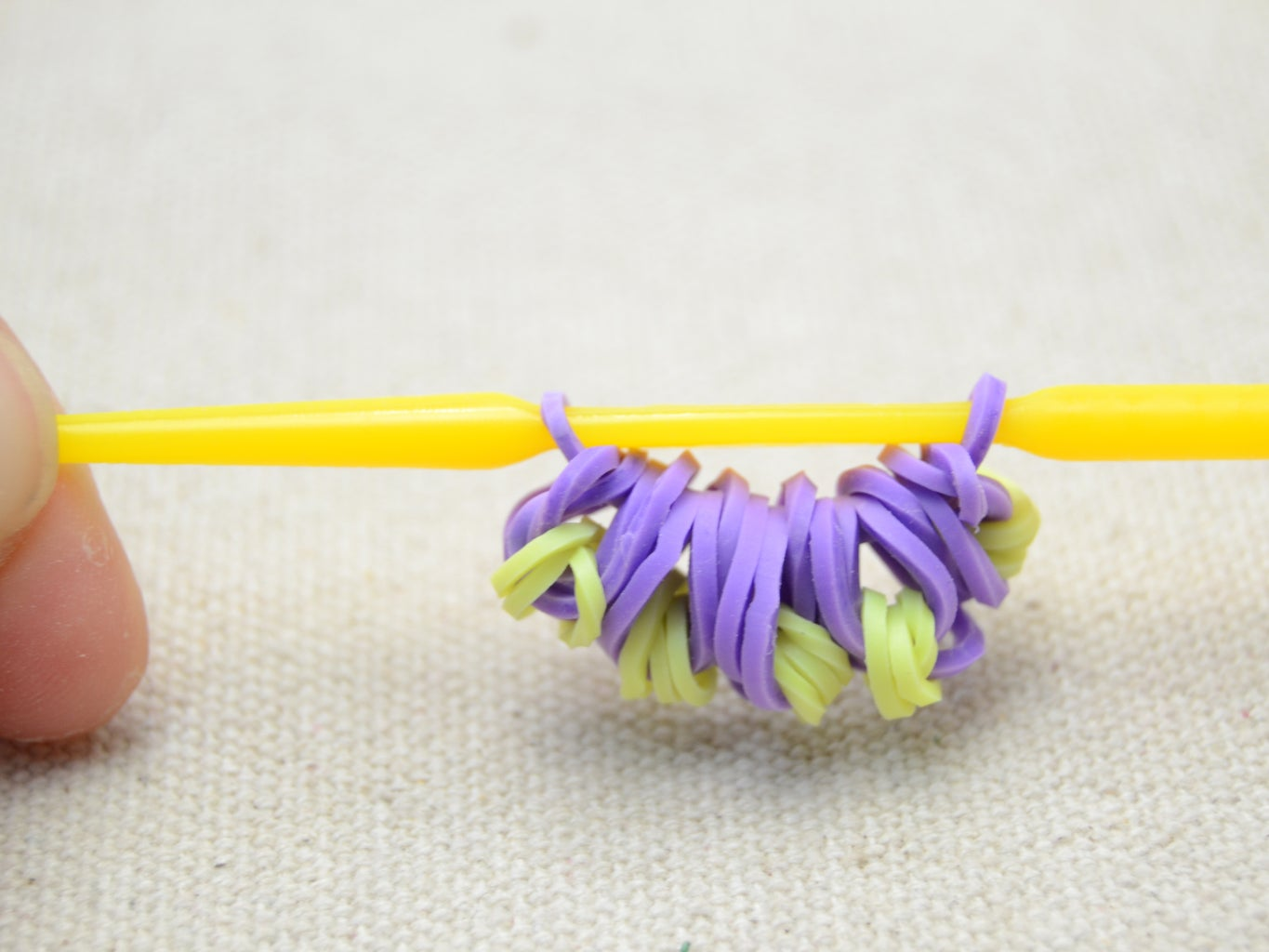 Slip the Five Petals to a Purple Rubber  and Thread Two Ends of the Purple Band to Hook;