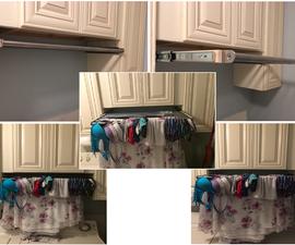 在洗衣柜下滑动干衣机