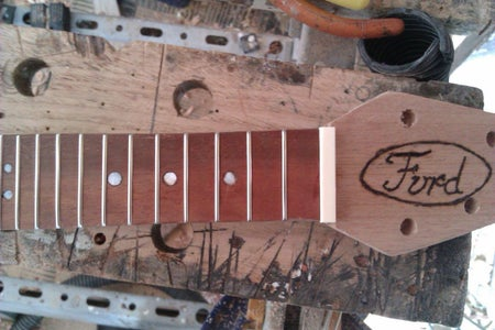 Decorate Your Headstock and Add a Nut