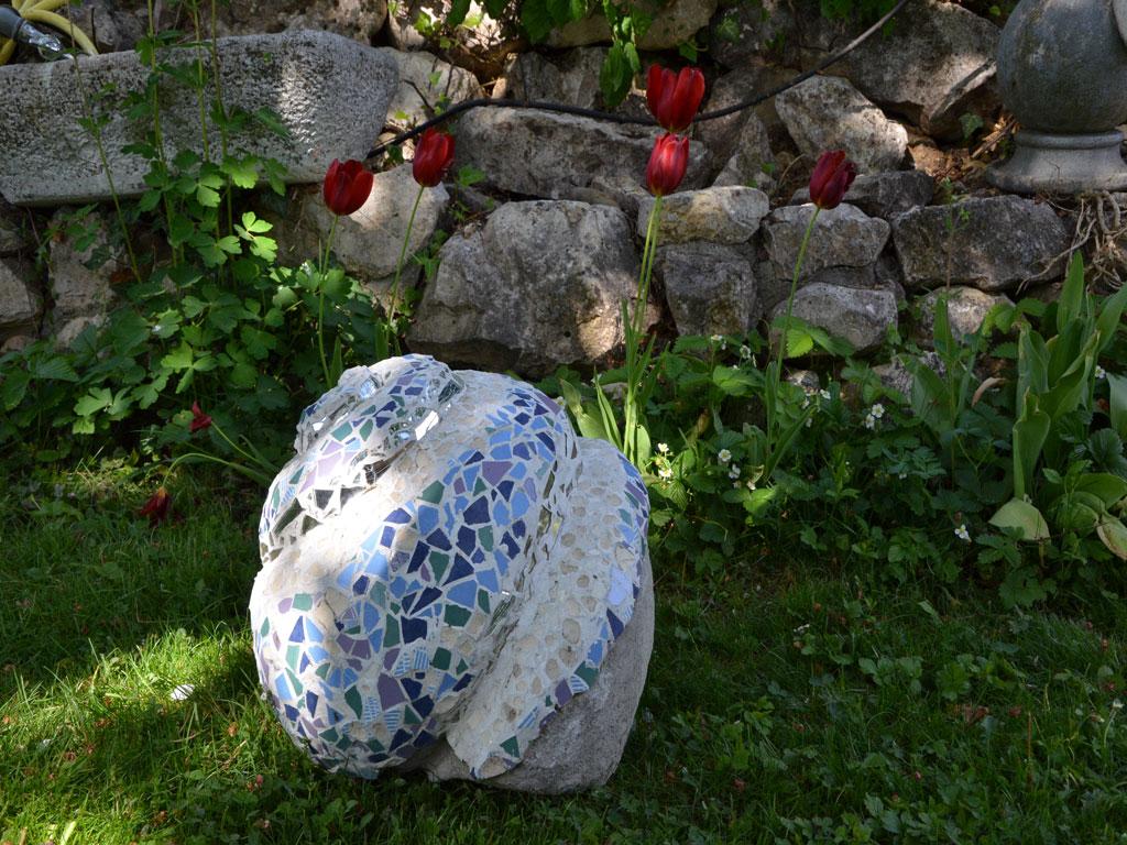 garden sculpture with mosaic