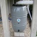 Refitting a Great American rain barrel with a new heavy duty spigot.
