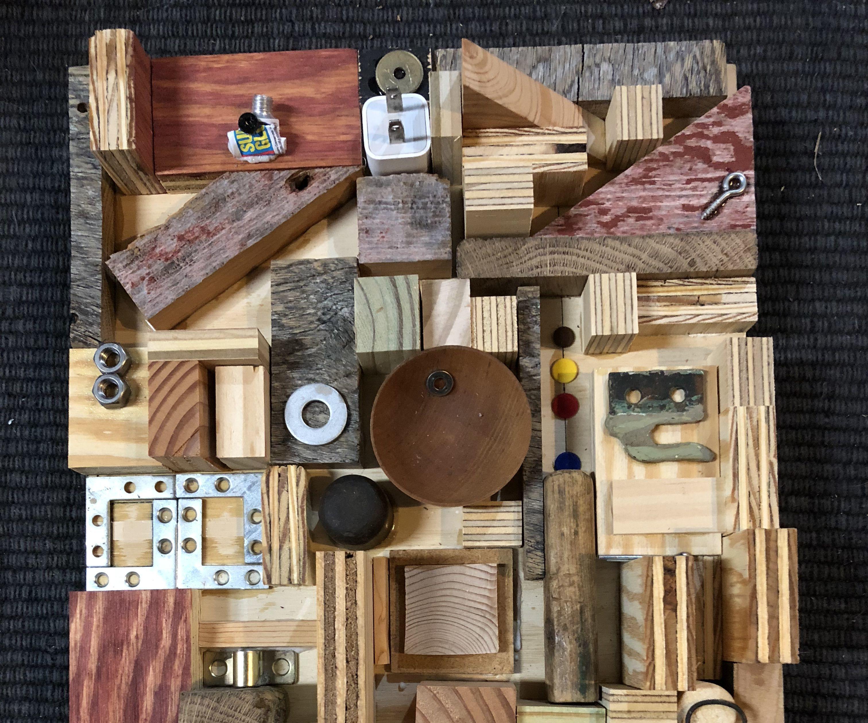 Random Found Items Glued to Plywood