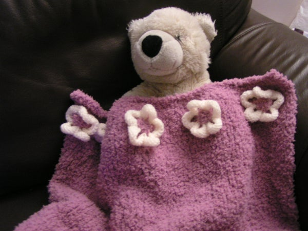 A Flowered Baby Blanket.