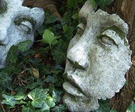 巨大的DIY混凝土脸上花园雕塑