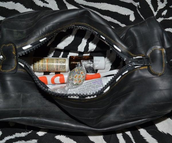RECYCLED INNER TUBE BEAUTY CASE BAG