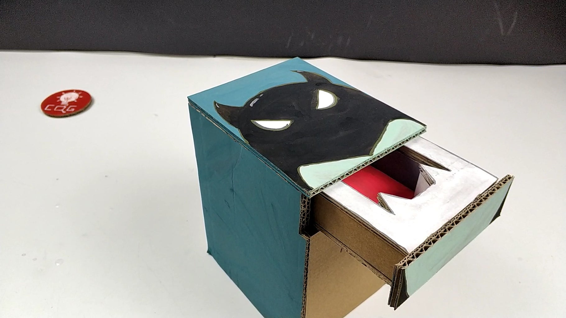 How to Make a Small Demon Magic Piggy Bank With Cardboard