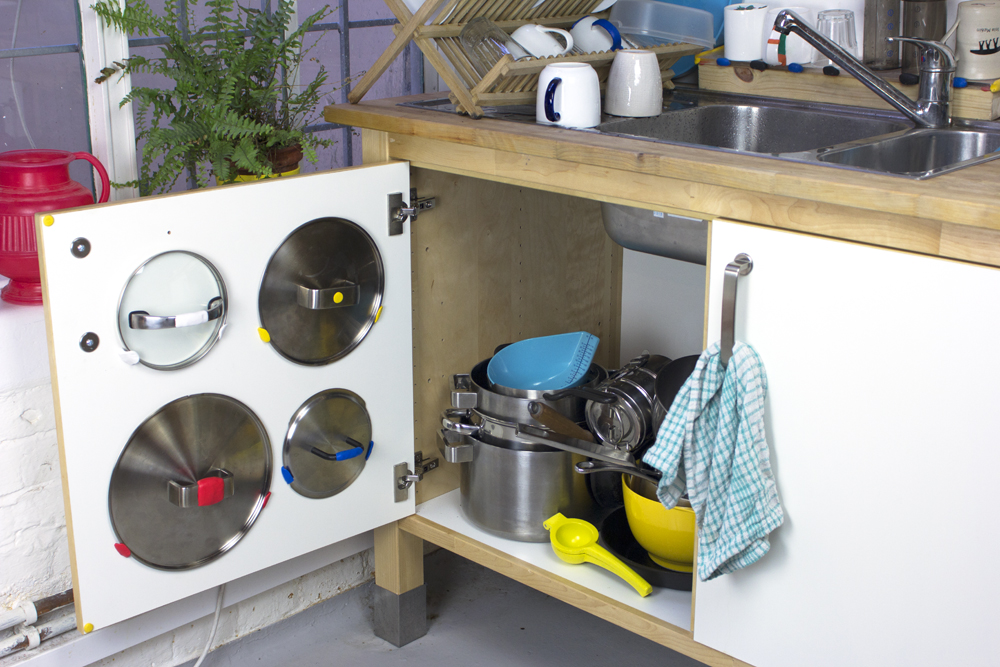 Organise messy cupboards with sugru. At last - a good solution for pot lids!