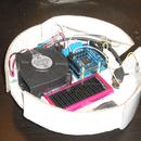 Another cardboard robot-vacuum-cleaner controlled with Arduino