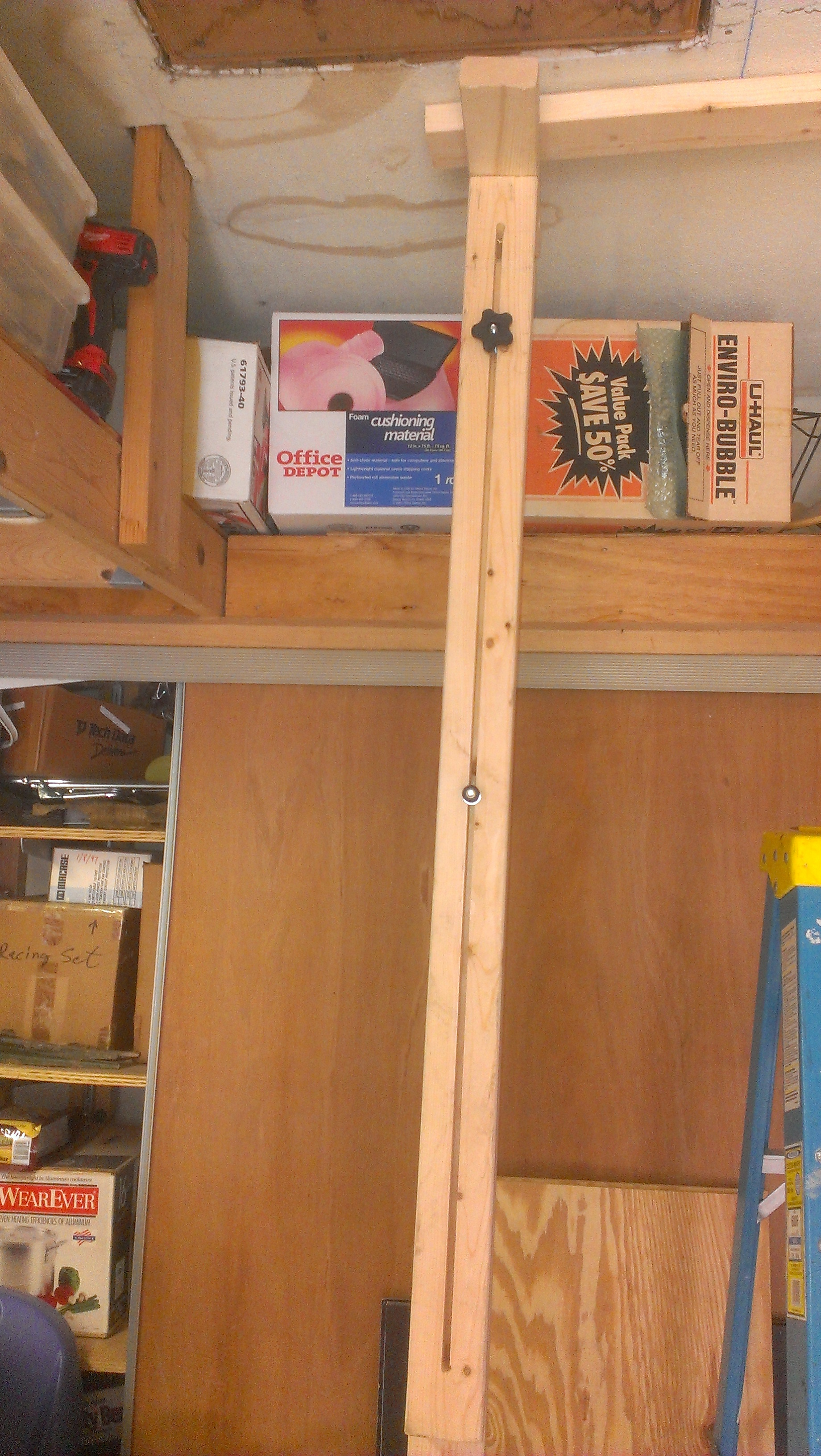 Third hand for affixing molding, 2 x 4s, or drywall to a ceiling