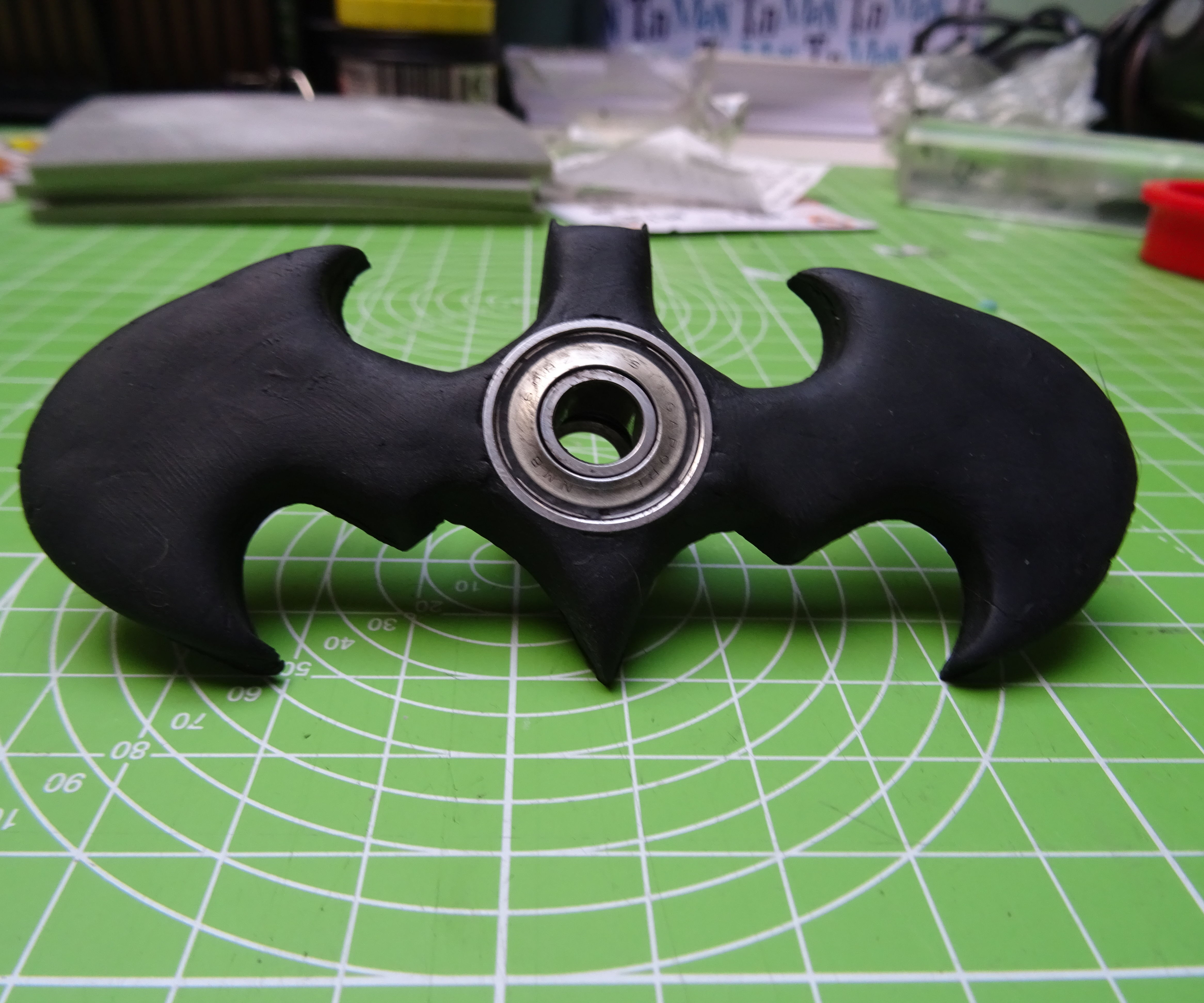 Batman logo spinner toy