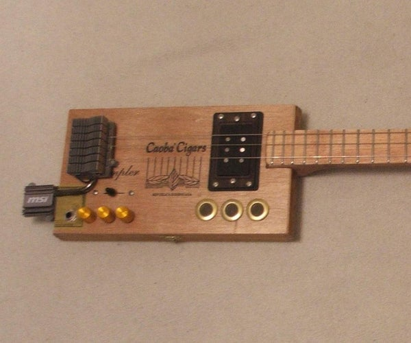 3 Guitars Made From a Table. #2 the Cybar Box Guitar