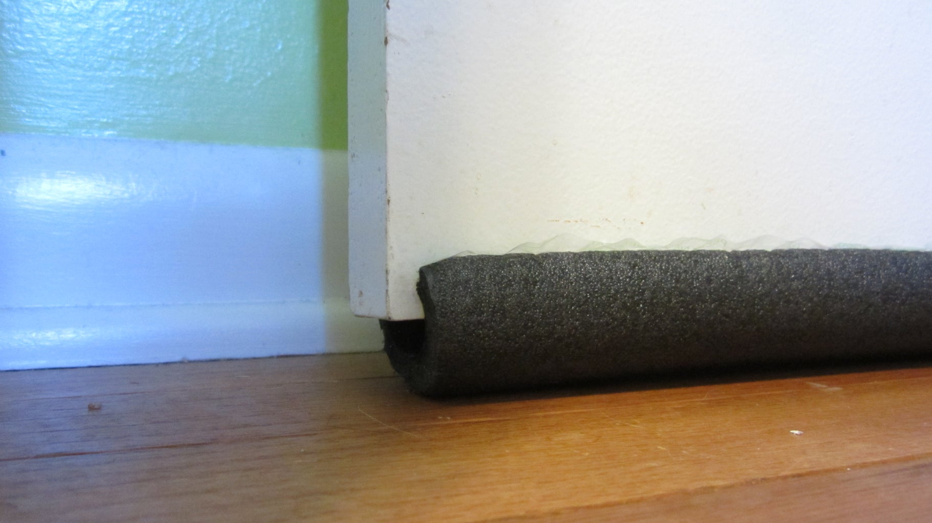Use Pipe Insulation to Fill Gaps Below Doors