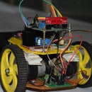 DTMF and Gesture Controlled  Robotic Wheelchair