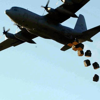 US_Navy_061210-N-7770P-007_Bundles_of_shelters_and_mosquito_nets_are_dropped_from_a_U.S._Air_Force_C-130_cargo_plane_onto_a_field_in_rural_Kenya.jpg