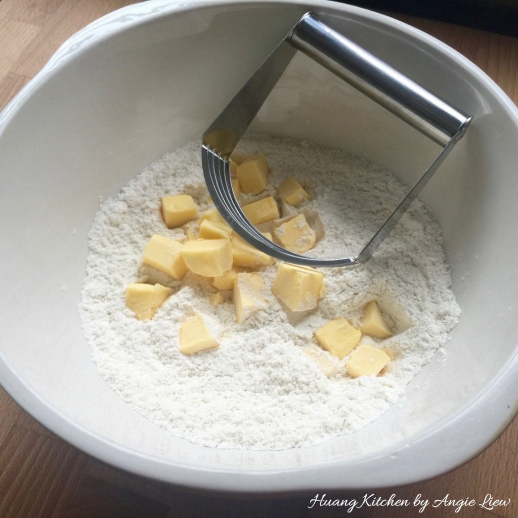 Rub Cold Butter Cubes Into the Flour Mixture.