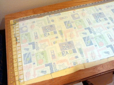 Cut Scrap Fabric Pieces Into Rectangle 40 by 16 Inches (approximately).
