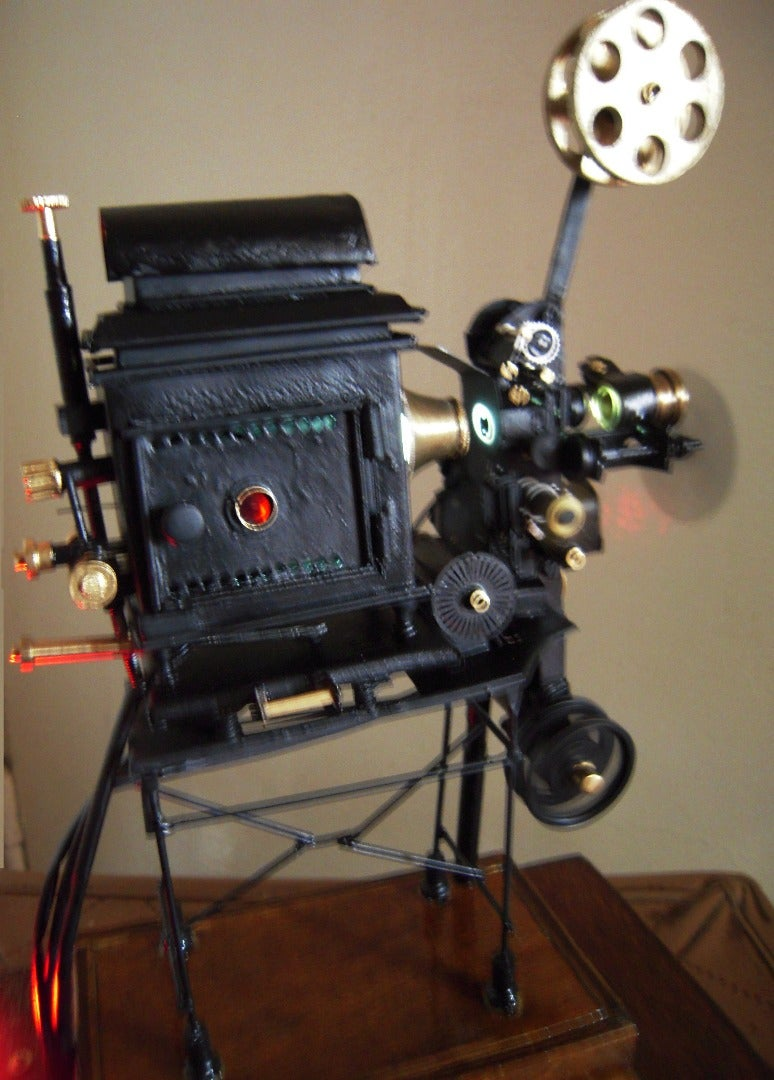A Miniature Working Model of a Film Projector