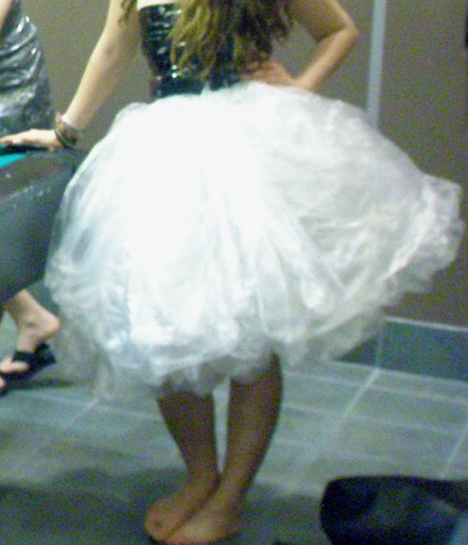 Make a poufy skirt out of garbge bags and duct tape