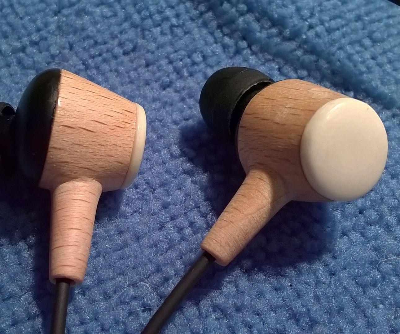Wooden earphones housing with bone cap