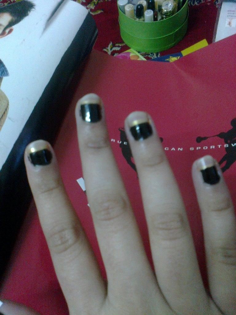 Apply Black Nail Enamel
