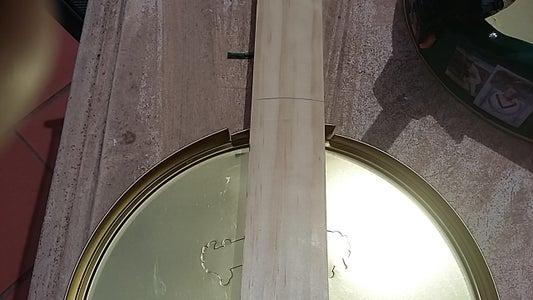 Deforming a Circular Tin Lid