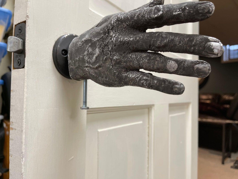 Attach Metal Hand to Doorknob