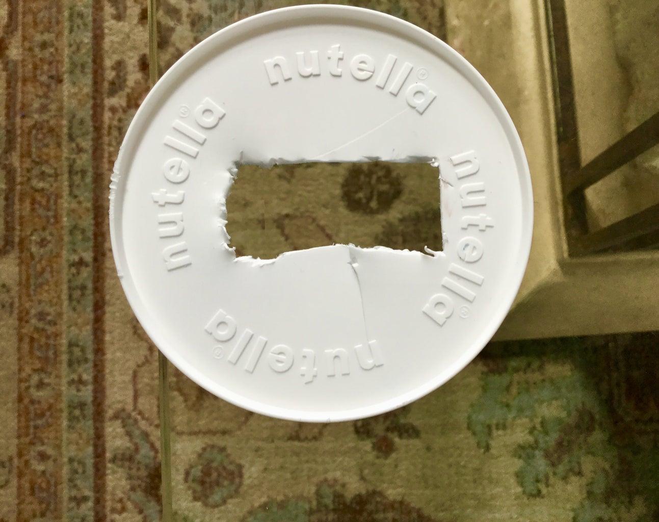 Cut the Cap of the Plastic Container