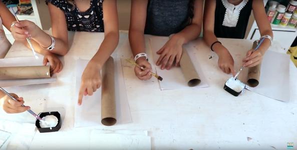 Begin Wrapping Paper Rolls in Scrapbook Paper