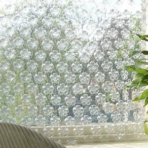 How to Turn the Bottom of a Plastic Bottle Into Flowers!