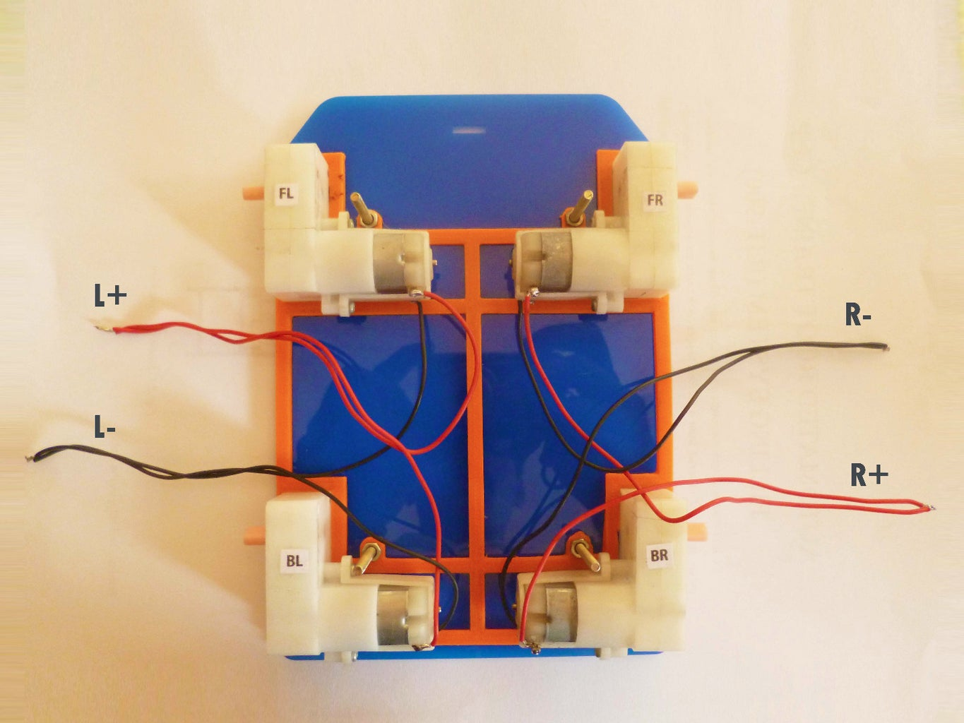 Place Motors on the Base and Put the Screws