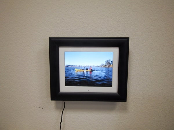 How to Make Hanging Pictures Easier and Keep Your Nail From Slipping Into the Wall