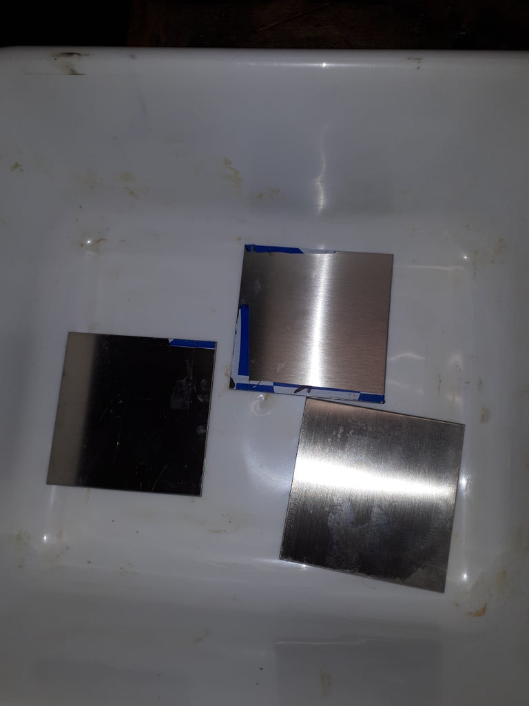 Plating the Gold Solution to Stainless Steel 1.5 Mm and 2 Mm Thickness Squares and Heating With Propane.